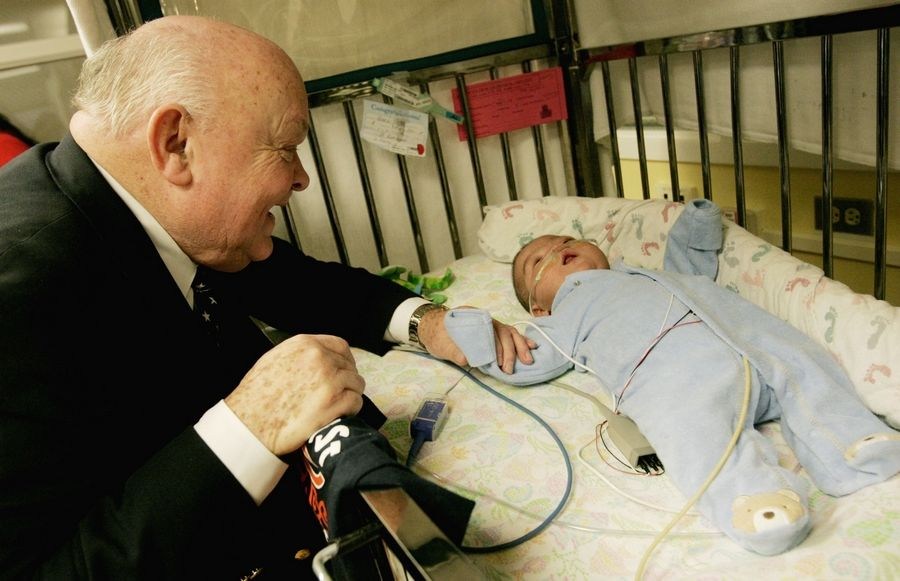 "Naperville Mayor George Pradel plays with baby Manny, who is his niece's grandson. ""It's a miracle,"" Pradel said. ""For six months, we were hoping and praying."""