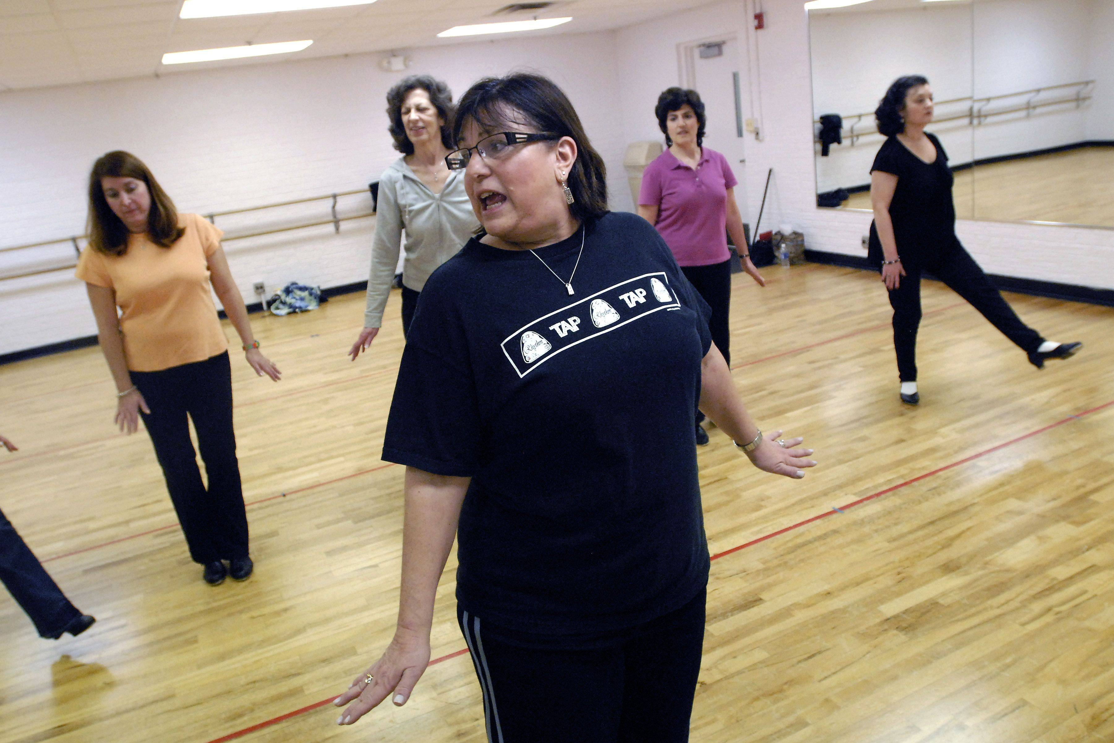 Instructor Franci Galinsky shows students a new routine during advanced tap-dancing class at Emmerich Park in Buffalo Grove.