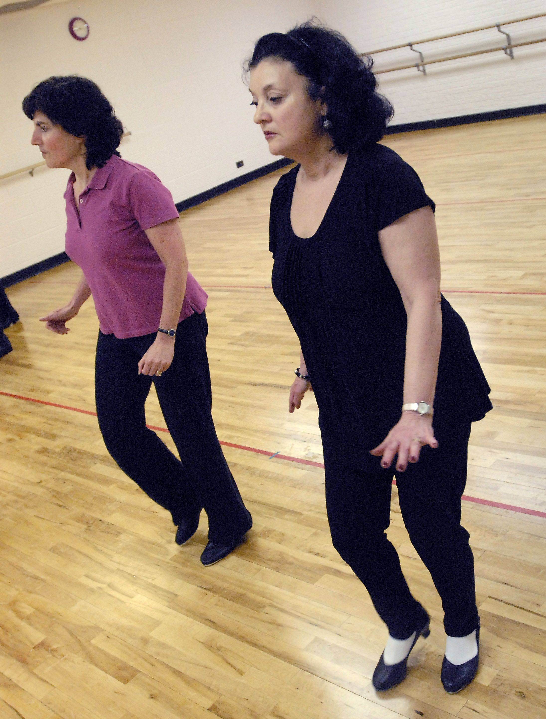 Stacey Lavy, left, and Nancy Stieber are longtime members of the advanced tap-dancing class at Emmerich Park in Buffalo Grove.