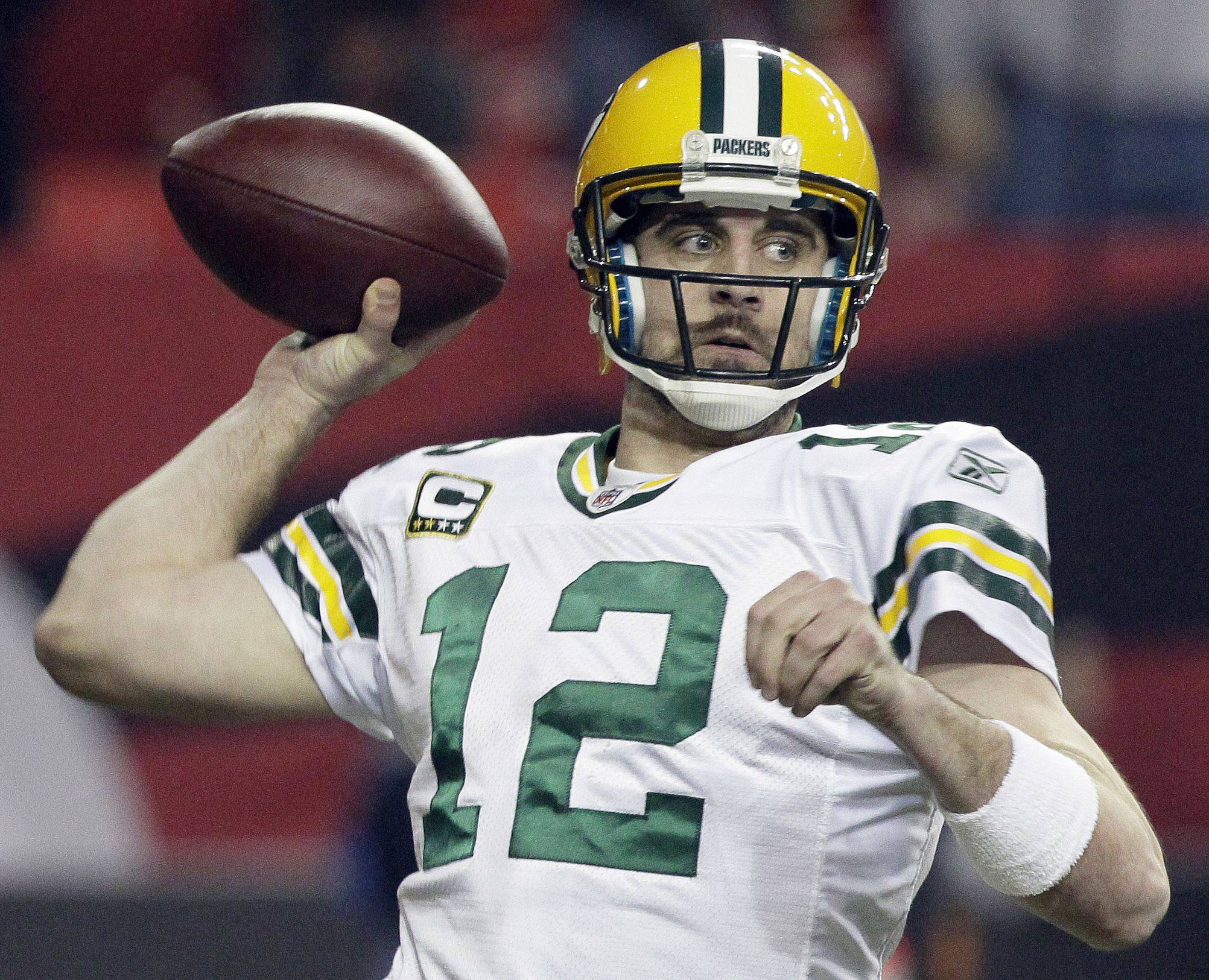 Green Bay Packers quarterback Aaron Rodgers passes against the Atlanta Falcons during the second half of an NFL divisional playoff football game, Saturday, Jan., 15, 2011, in Atlanta.