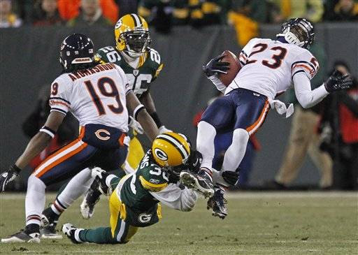 Green Bay Packers cornerback Tramon Williams tackles Chicago Bears wide receiver Devin Hester during an NFL football game in Green Bay, Wis. earlier this month.