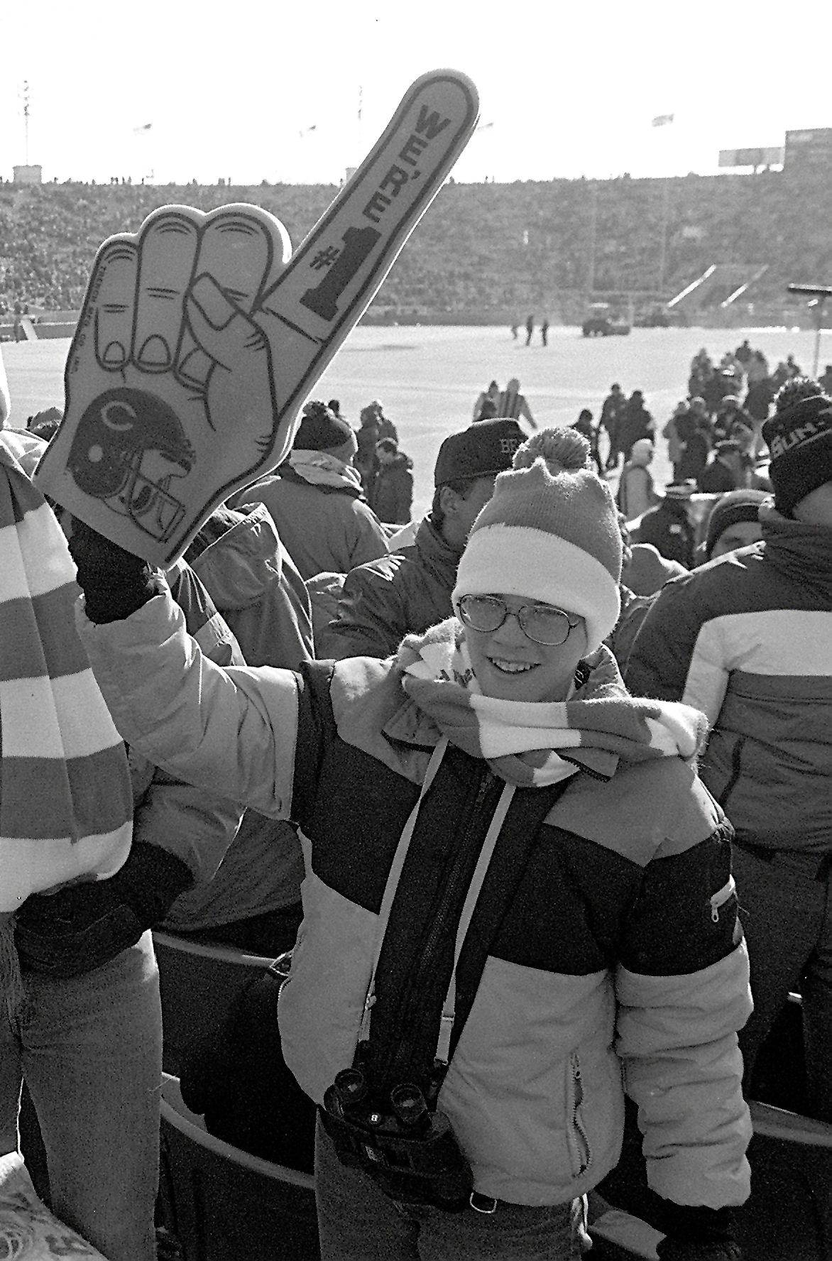 Cheering the Bears to a 21-0 playoff victory on a frigid day 25 years ago at Soldier Field, 12-year-old Brady Smith, far right, of Barrington dreamed of playing in the NFL. Not only did he grow up to play for more than a decade, but Smith recorded a playoff safety as a defensive end with the Falcons, near right.