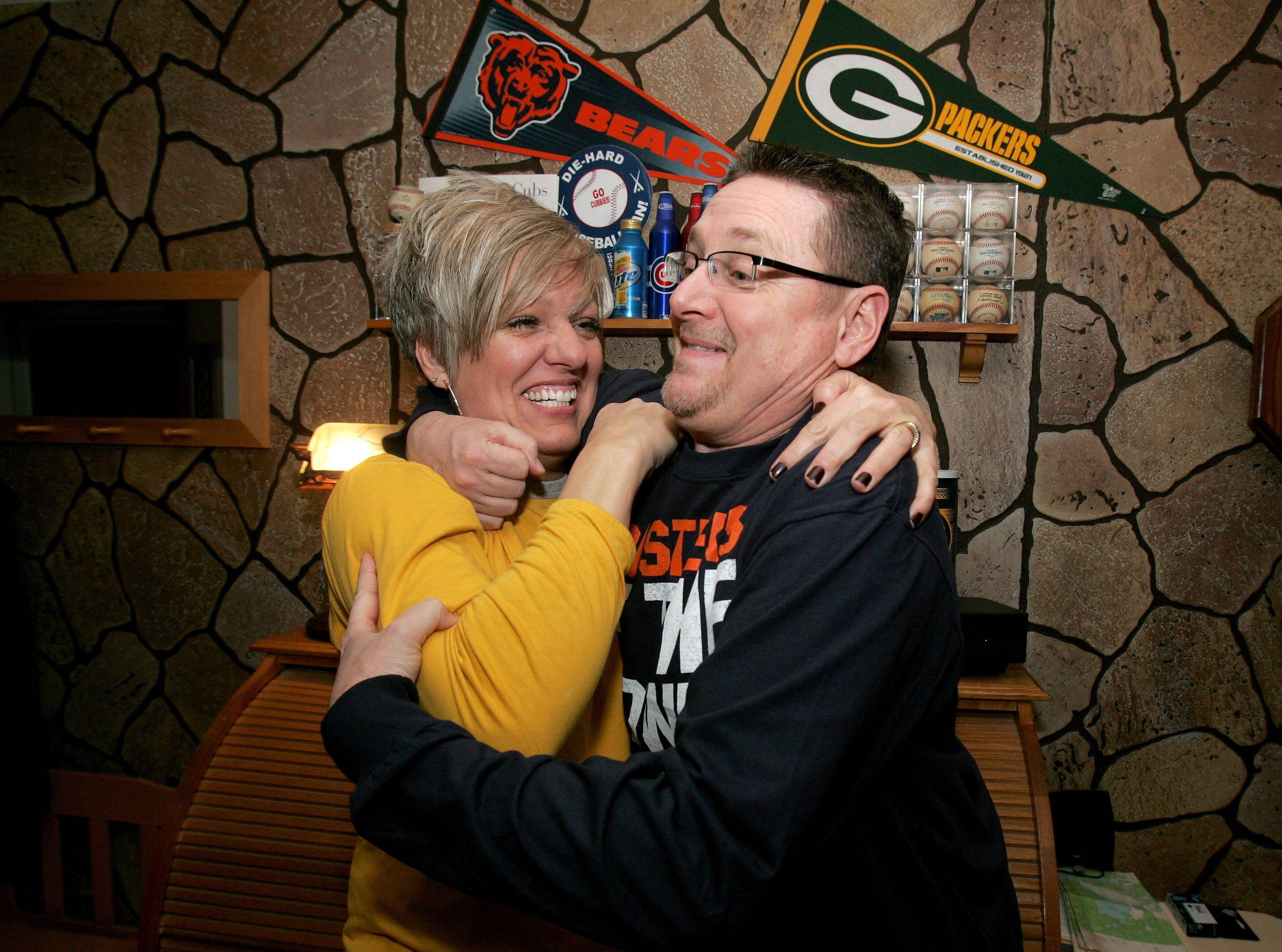 Bev Horne/bhorne@dailyherald.comBob and Lisa Bosma of Lombard will be rivals this weekend for the Chicago Bears vs. Green Bay Packers playoff game.