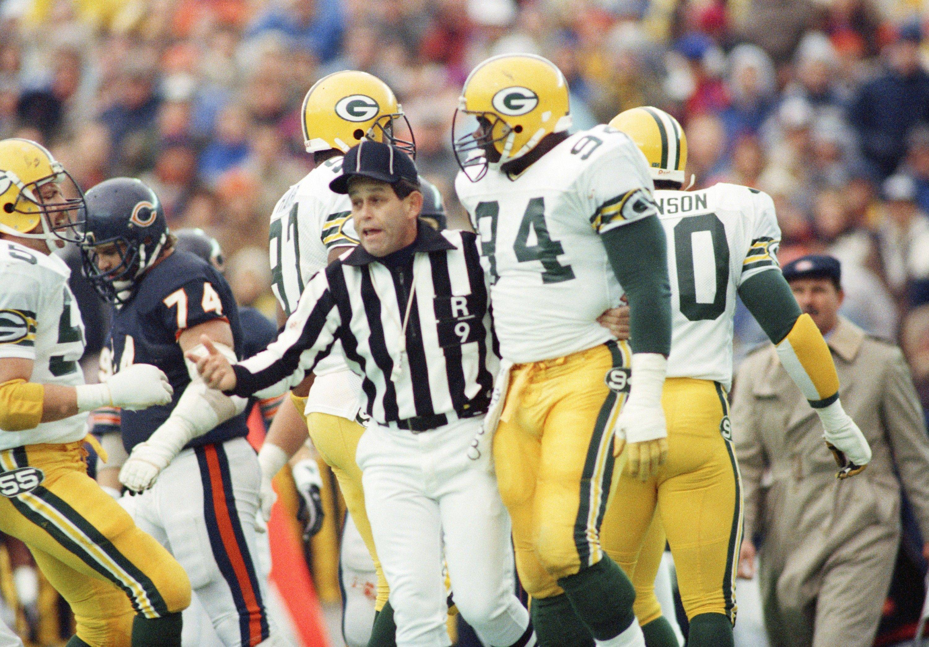 Green Bay defensive lineman Charles Martin, is ejected from the game for roughing up Bears quarterback Jim McMahon, Nov. 25, 1986 in Chicago. He was suspended for two games, the most severe penalty handed down for an on-the-field incident in Commissioner Pete Rozelle's 26 years.