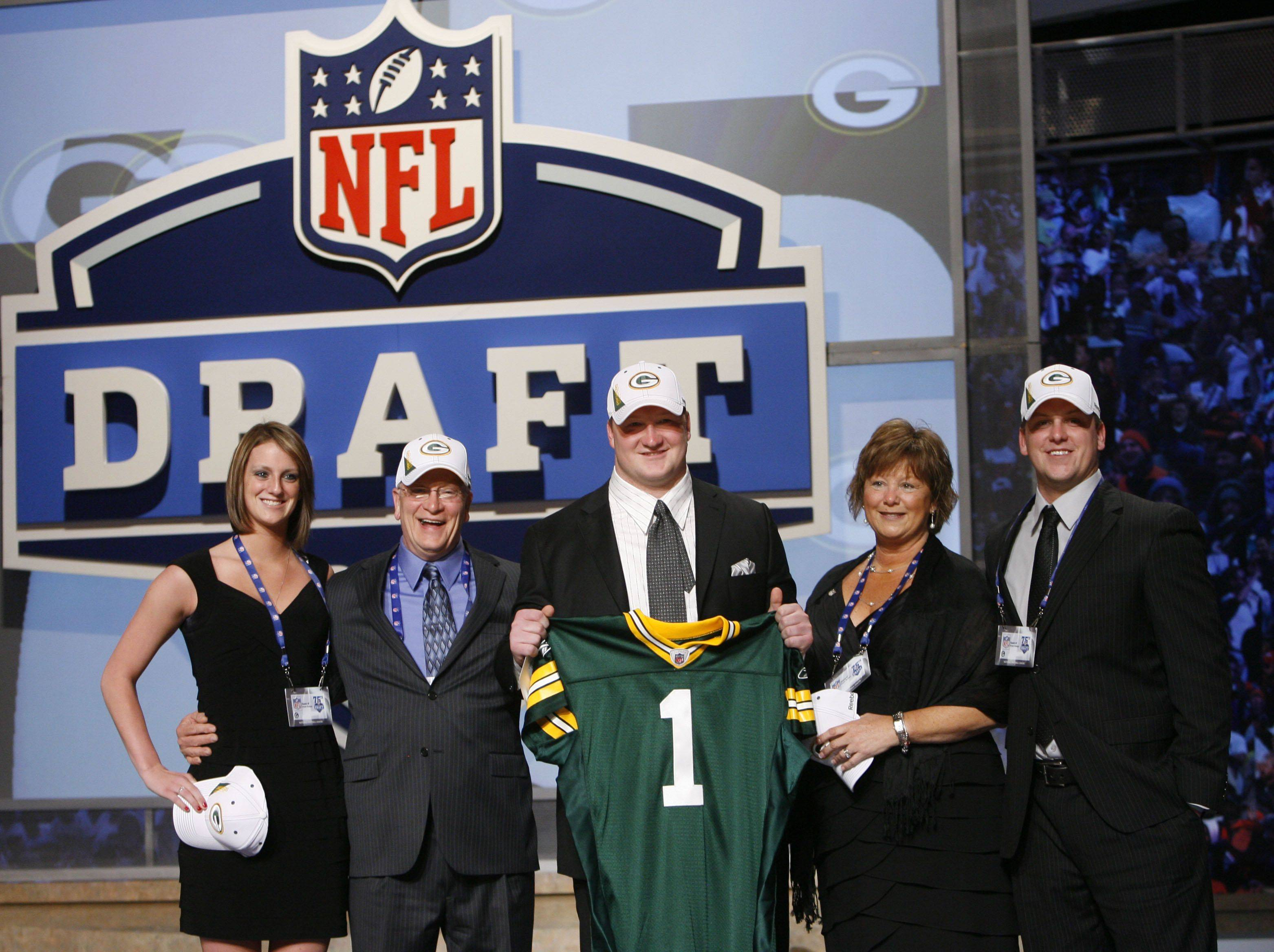 Crystal Lake native Bryan Bulaga, surrounded by loved ones, holds up his Green Bay Packers jersey after the Packers picked him in the first round of the NFL draft at Radio City Music Hall on April 22, 2010, in New York.