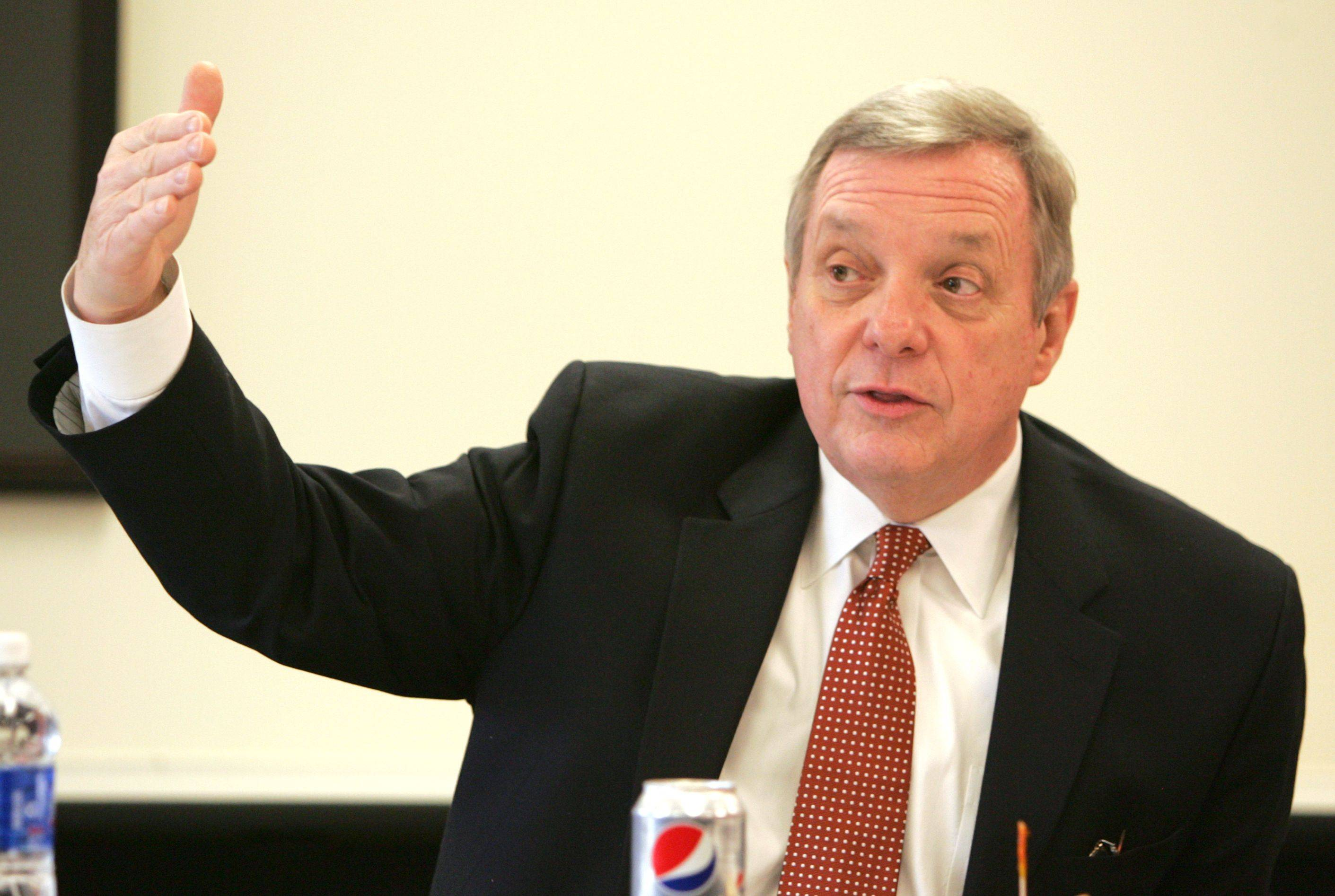 Sen. Dick Durbin promised Thursday to push a change to federal legislation that would allow online retailers to collect Illinois sales tax at the time of a purchase.