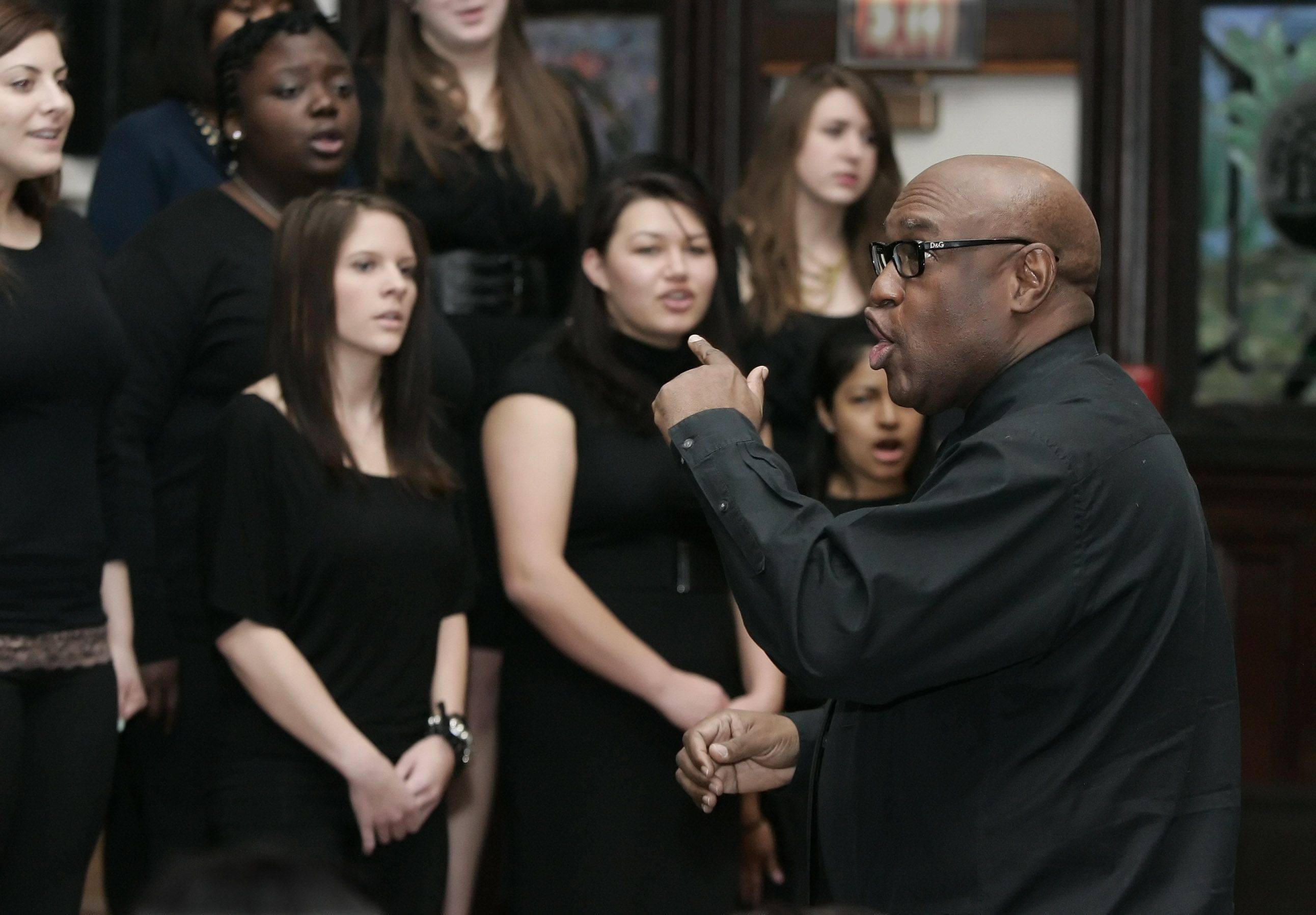 Glenn Johnson leads the Lake Forest College Choir during the Annual Martin Luther King, Jr. Holiday Program Monday in the Lily Reid Holt Memorial Chapel at Lake Forest College.
