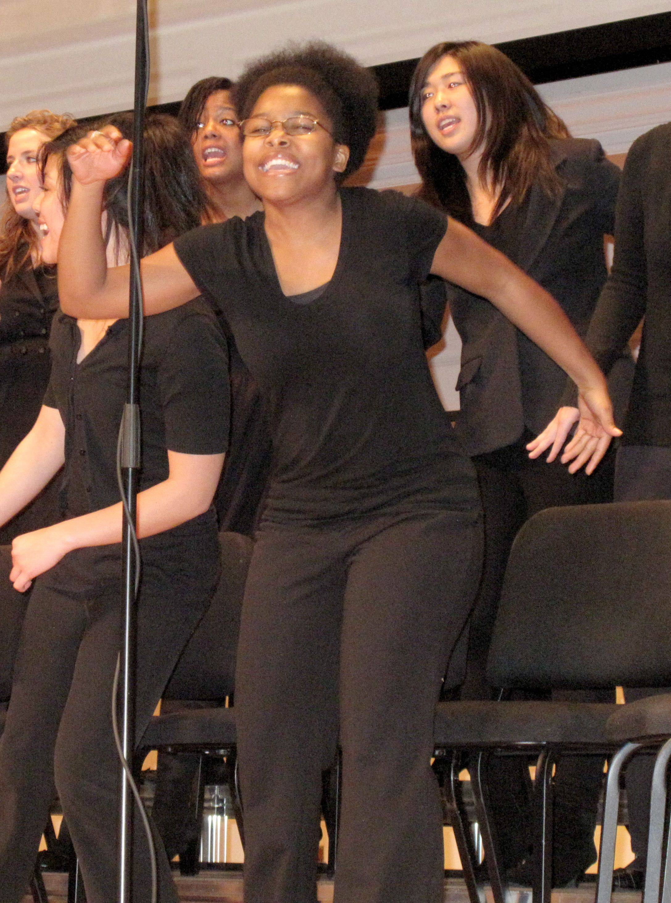 Wheaton College senior Tiffany Egler gets into her performance as part of the Wheaton College Gospel Choir on Monday, Jan. 17.