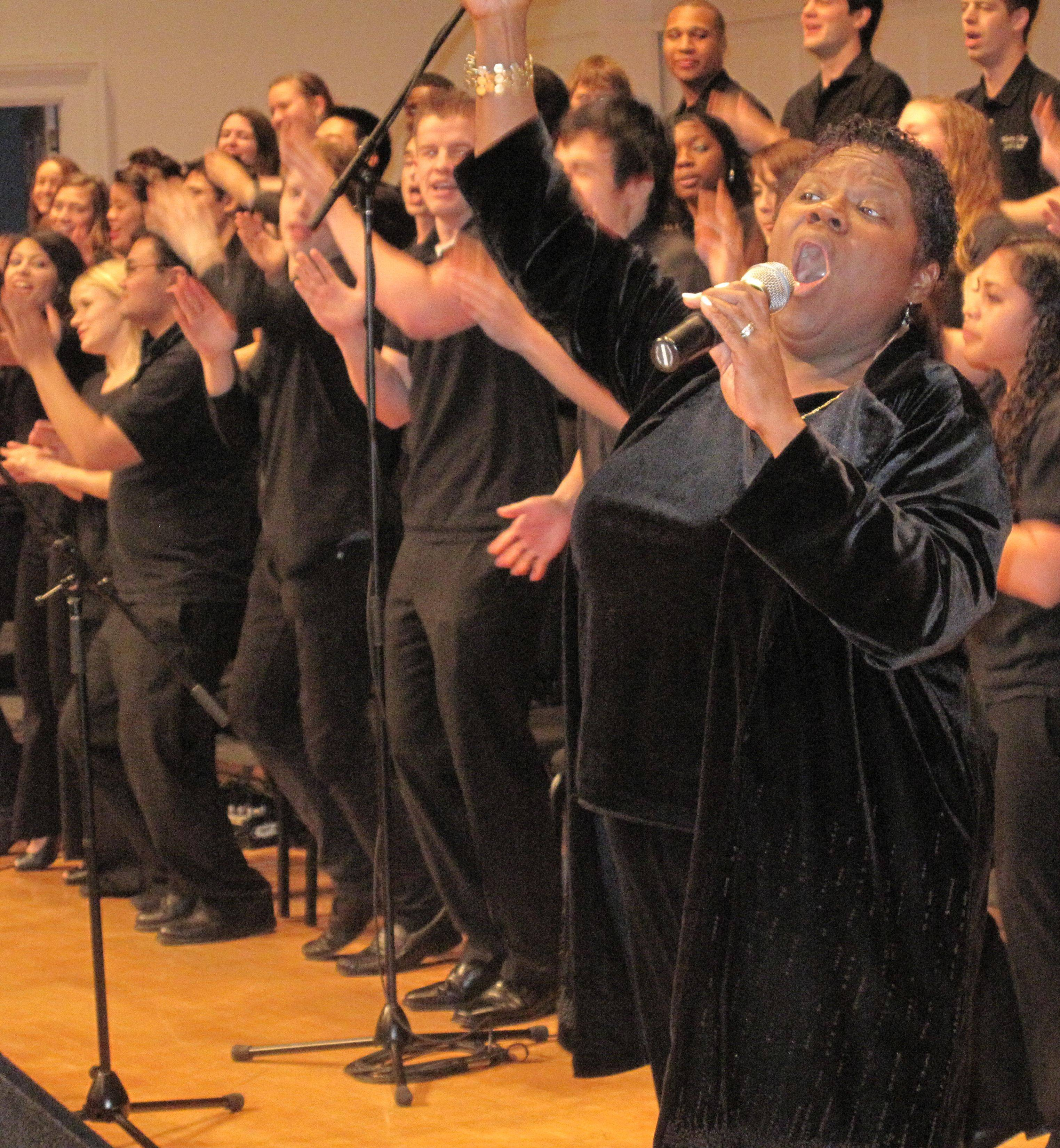Wheaton College Gospel Choir Director Tanya Egler lead her singers during Monday's celebration of Martin Luther King Jr. Day at the school. The Monday, Jan. 17, event marked the 21st straight year the day has been celebrated in DuPage County.