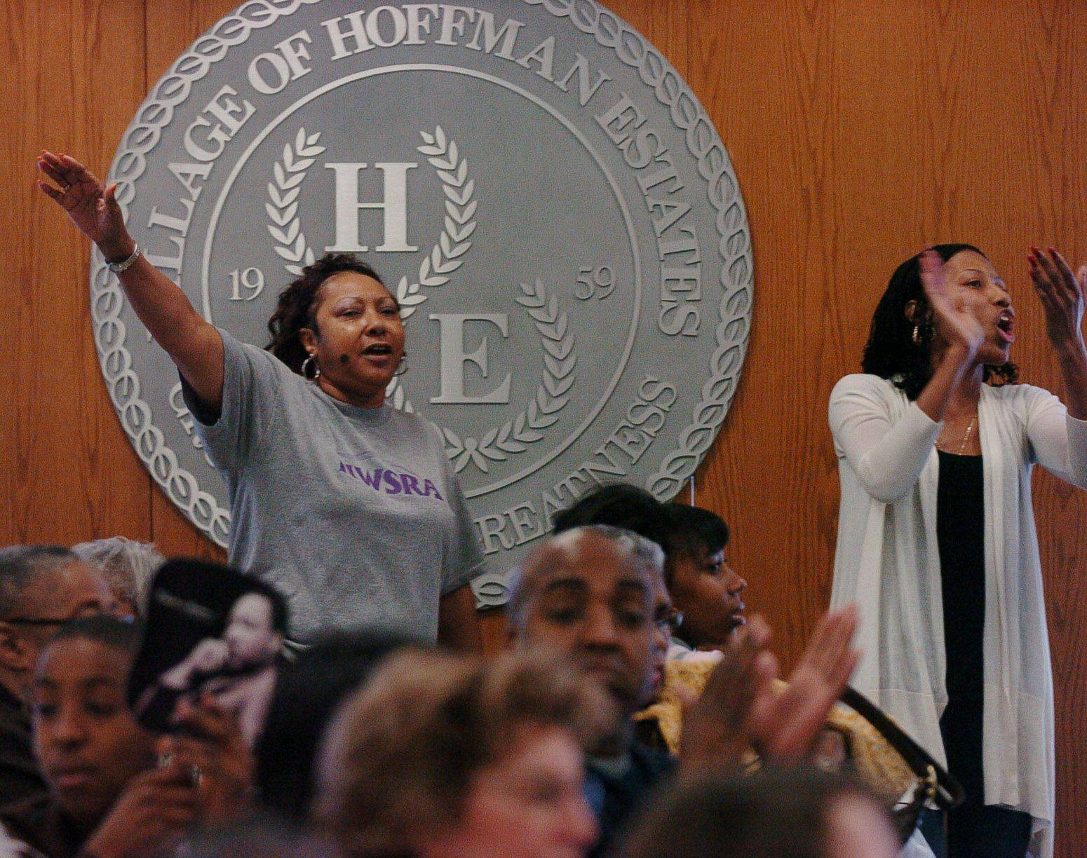 Estelle Young, left, and Santana Ross get up and dance to the Sears Holdings Chorus during the Ninth Annual Martin Luther King Jr. Community Breakfast on Hoffman Estates.