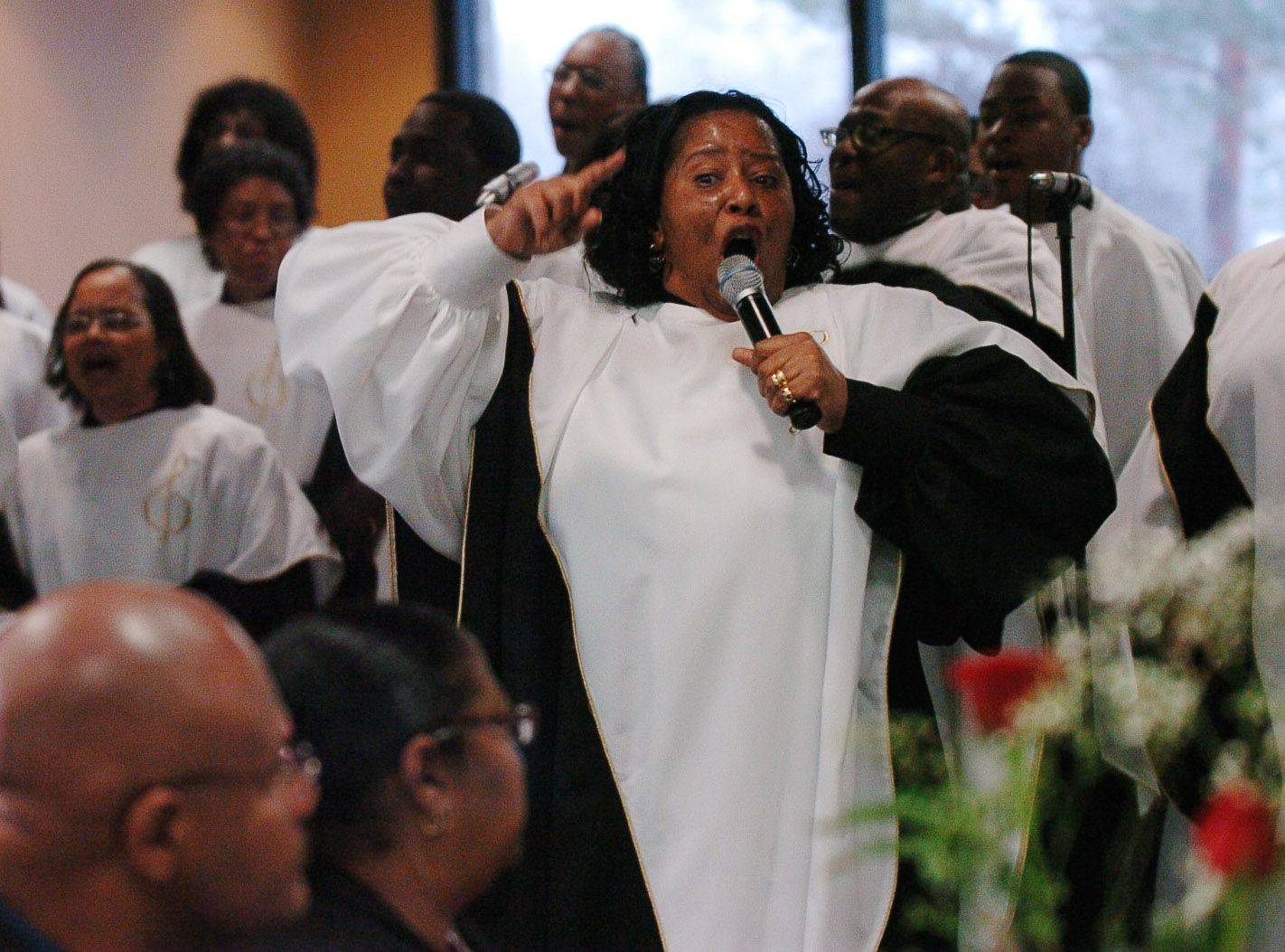Faye Meeks performs with the Sears Holdings Chorus during The Village of Hoffman Estates Ninth Annual Martin Luther King Jr. Community Breakfast.