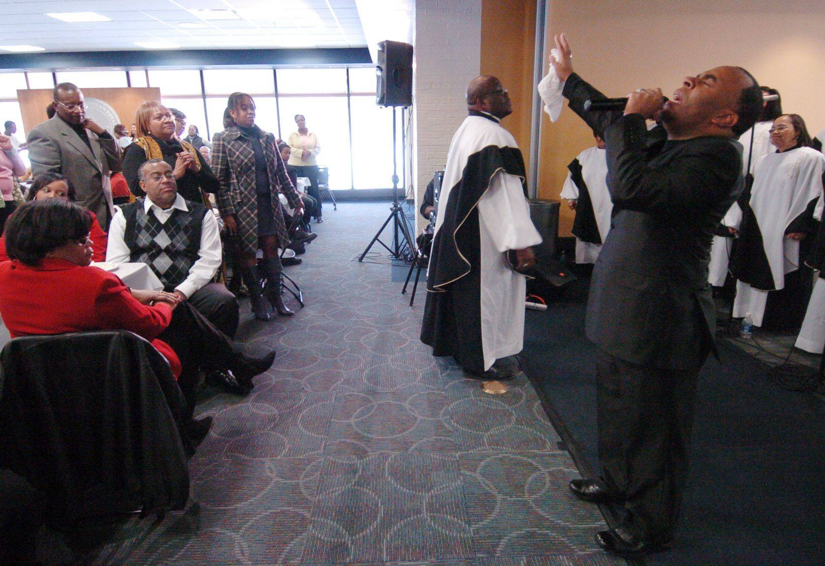 "Soloist Tim White of the Sears Holding Chorus brings the crowd to their feet with the song, ""He Cares"", during The Village of Hoffman Estates Ninth Annual Martin Luther King Jr. Community Breakfast."