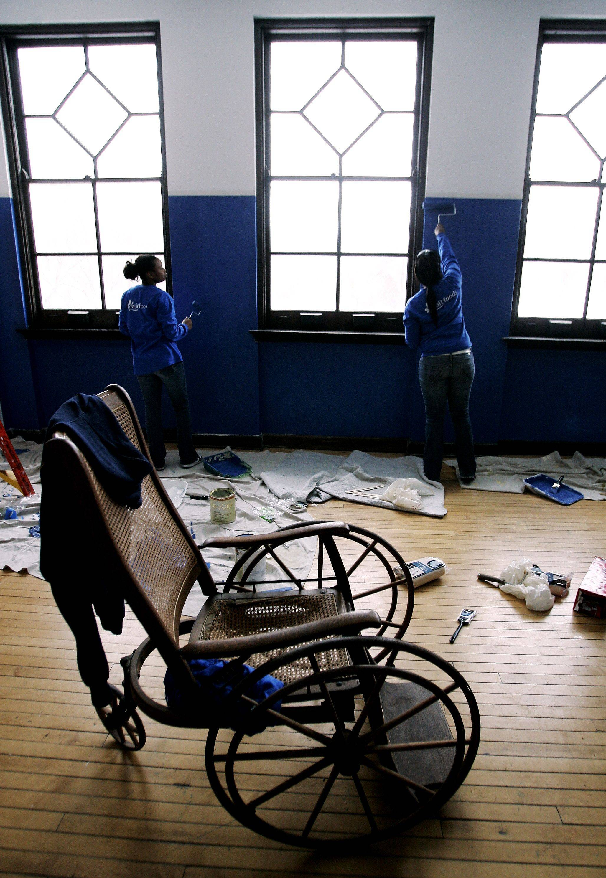 LaDana Givens, 18, of North Chicago, left, and Savannah Bush, 21, of Waukegan paint a room at Great Lake Adaptive Sports Association in Lake Forest Monday as students from YouthBuild Lake County participate in community service projects for Martin Luther King Day.