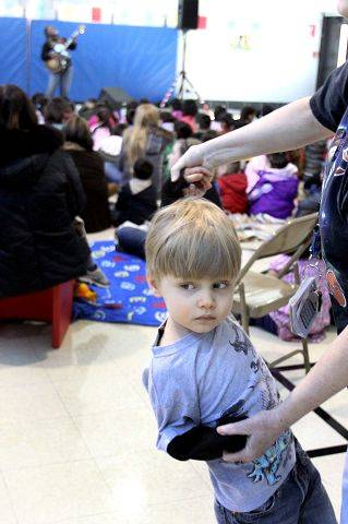 Noah Henderson, 4, dances with classroom aide Marge Smolinski as Grammy Award nominee Ruthie Foster performs Friday at Ardmore School in Addison.