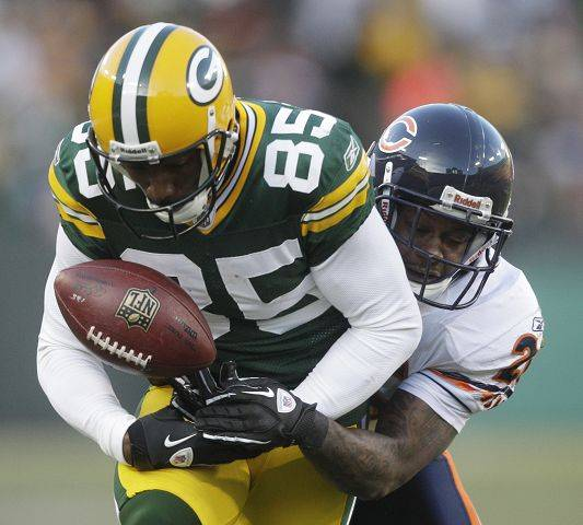"While the Packers have four wide receivers with 45 catches or more, Greg Jennings is clearly their No. 1 with 76 catches, 1,265 yards and 12 touchdowns. Says Bears cornerback Charles Tillman: ""He's their playmaker, one of their money makers."""