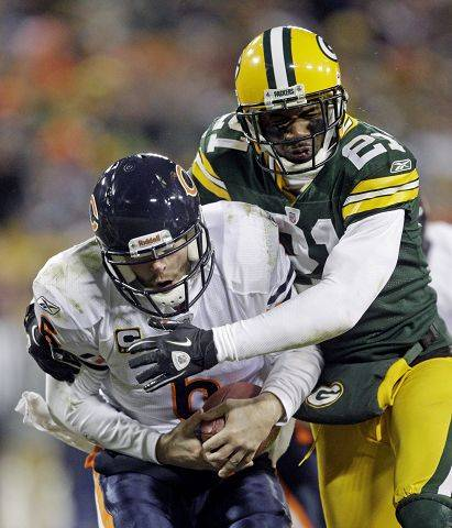 "At age 34, Packers cornerback Charles Woodson is still making big plays, such as this sack of quarterback Jay Cutler in Green Bay's 10-3 win on Jan. 2. Says Bears TE Greg Olsen: ""He's done it for a long time. He can play corner, he can play nickel, and he's almost like a linebacker at times."""