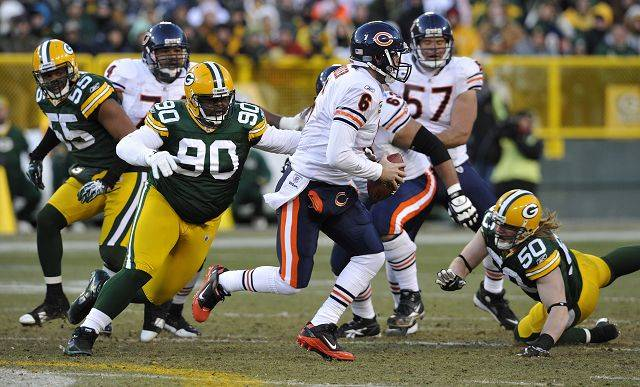 "Green Bay Packers' B.J. Raji (90) sacks Jay Cutler during the Bears's 10-3 loss to the Packers on Jan. 2 in Green Bay. Raji is a force in the middle of Green Bay's 3-4 defense, and he'll play fullback on the goal line. Says Bears head coach Lovie Smith: ""He's a solid run guy, a hard guy to move."""