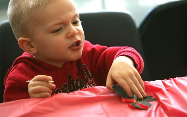Clayton Henning, 2, of Woodridge works on his crafts Saturday during the Lombard Park District's Winter Carnival at the Lombard Community Building.