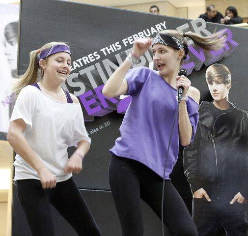 Ava Heemsoth, 14, right and Audrey Barber, 13, both of Elmhurst, try their chance at a trip to L.A. and a chance to meet Justin Bieber. Heemsoth had her friends act as back-up dancers during her rendition of Baby during the contest held at the Yorktown Center in Lombard.
