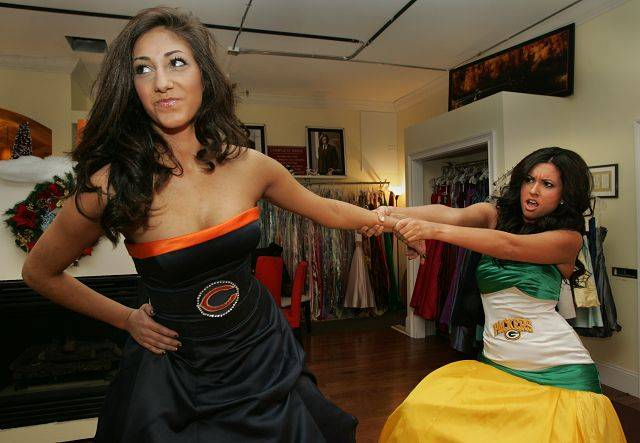 David Gafke at Complete Bridal Salon in East Dundee has created Chicago Bears and Green Bay Packers wedding gowns. Models Tali Ilani, 15, and Nicki Loizzi, 21 wear the Bears and Packers gowns respectively. Both are from Elgin and will be modeling the dresses at the NFC Championship this weekend at Soldier Field.