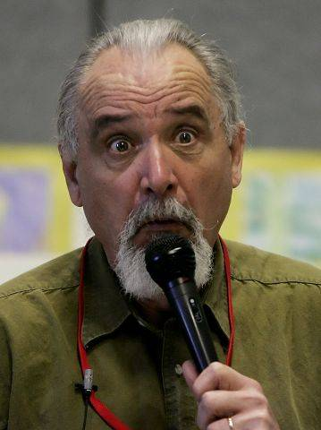 Storyteller and author Jim May share stories with fifth grade students Wednesday at O'Plaine School in Gurnee.