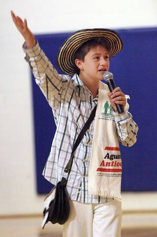 Colombian Exchange student Santiago Pailla, 14, tells a Columbian folk tale as 26 other exchange students presented a music and dance program for Hawthorn Middle School North Thursday in Vernon Hills.
