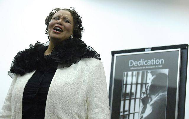 Dr. Rise Jones of Elgin sings at the 26th-annual Prayer Breakfast at Elgin Community College's Business Conference Center on Saturday, January 15 in honor of Dr. Martin Luther King, Jr. The day-long event started with a breakfast and concluded with a musical program. Dr. Jones is part of the non-for-profit Elgin organization Hamilton Wings, an arts organization for diverse, economically and socially disadvantaged children.