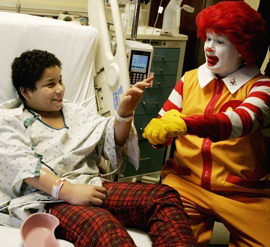 Ronald McDonald performs some tricks for patient Jeremy Grove Tuesday as The Edward Foundation and Ronald McDonald House Charities of Chicagoland and Northwest Indiana announced plans to bring the first Ronald McDonald Family Room in Illinois to Edward Hospital.