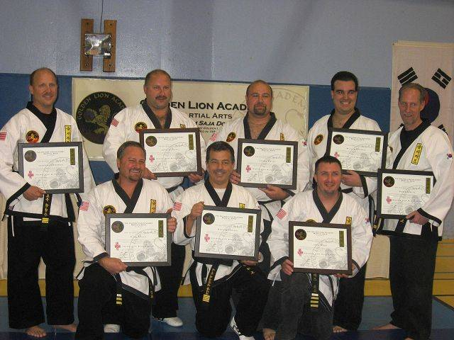 Pictured, back row: Joe Anderson, Master John Paoli, Master Jason Estes, Rich Conforti and Dan Schmitz; front row: Rich David, Matt Raimondi and Jeff Rose, all Golden Lion martial arts instructors.