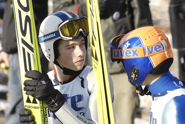 Matt Doyle, left, and Luke Daniels, both 13 and from the Andover Outing Club in New Hampshire, rest and watch after competing in the J2 Class in the 105th annual Ski Jump Tournament hosted by they Norge Ski Club last year.