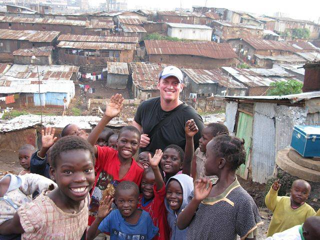 Putting smiles on the faces of children living in some of Africa's poorest and filthiest slums brings an equally big smile to the face of Geneva's Justin Ahrens, whose Rule 29 design firm has donated hundreds of hours helping the charity Life In Abundance.