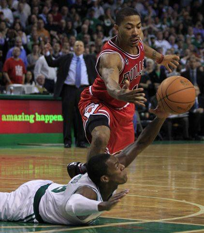 Associated PressCeltics guard Rajon Rondo, bottom, dives as he tries to control the ball against Bulls guard Derrick Rose in November.