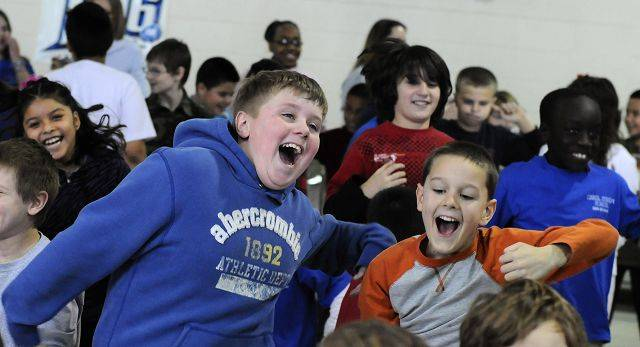 Third graders Nick Christopher, left, and Sean O'Boyle work off some calories to music at dance and health lesson Friday at Carol Stream School in Carol Stream.