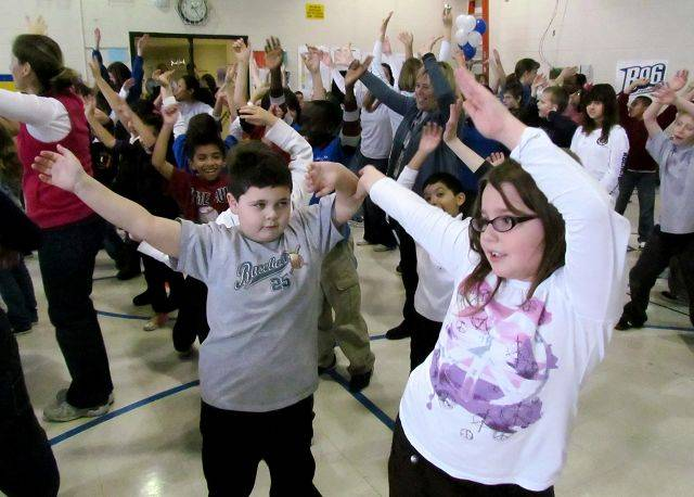 Justin Kenny, left, and Alyssa Cooper do a warmup number during a dance and health lesson Friday at Carol Stream School in Carol Stream.