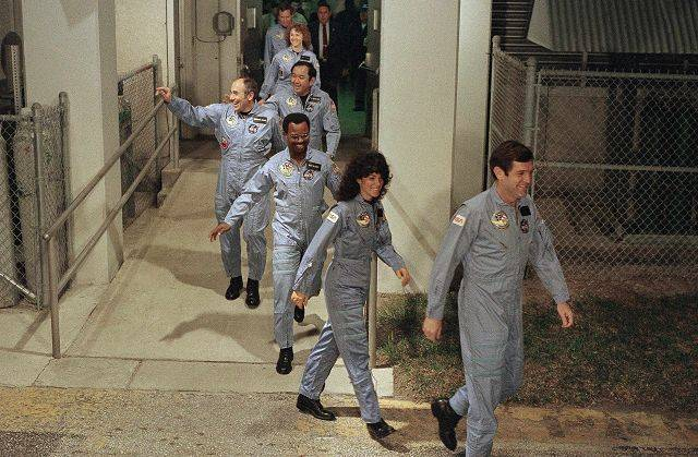 The crew members of space shuttle Challenger flight 51-L, leave their quarters for the launchpad at Kennedy Space Center in Cape Canaveral, Fla. From foreground are commander Francis Scobee, Mission Spl. Judith Resnik, Mission Spl. Ronald McNair, Payload Spl. Gregory Jarvis, Mission Spl. Ellison Onizuka, teacher Christa McAuliffe and pilot Michael Smith.