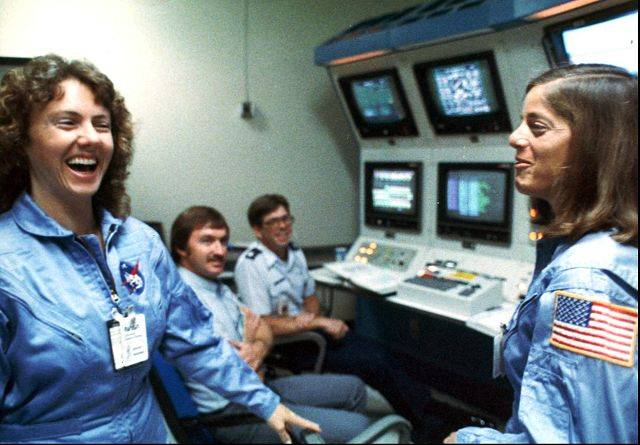 In this 1986 photo, Christa McAuliffe, left, and Barbara Morgan, right, laugh during training.