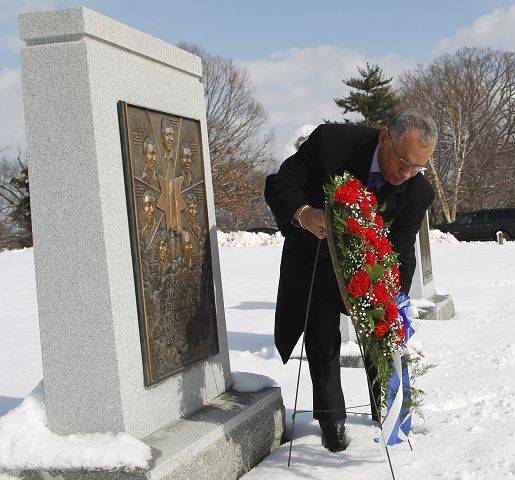 National Aeronautics and Space Administration Administrator (NASA) Charles Bolden lays a wreath at a Challenger memorial, at Arlington National Cemetery, in Arlington, Va.
