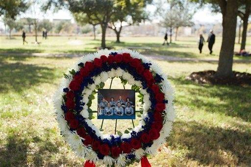 A wreath commemorating the seven astronauts who perished in the space shuttle Challenger accident rests in the Astronaut Memorial Tree Grove during the annual National Day of Remembrance ceremony at the Johnson Space Center