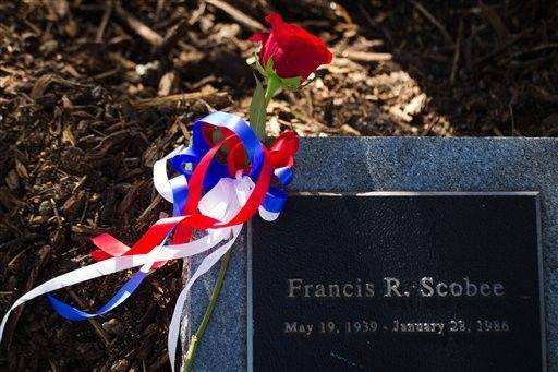 "A red rose rests on a marker for space shuttle Challenger commander Francis R. ""Dick"" Scobee during the annual National Day of Remembrance ceremony in the Astronaut Memorial Tree Grove at the Johnson Space Center."