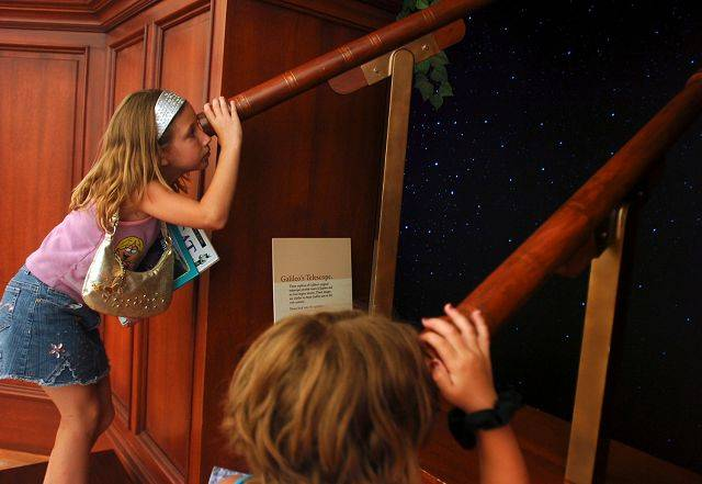 @SP Caption:A space exhibit at Gail Borden Public Library in Elgin brought Galileo's studio, which allowed children to peer through telescopes.