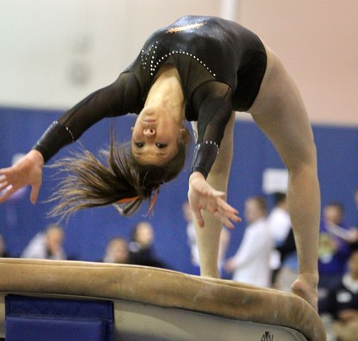 Libertyville's Leah Herchenbach competes on the vault at the North Suburban Conference girls gymnastics meet at Vernon Hills on Friday, January 28.