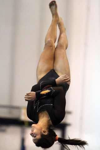 Libertyville's Jenna Dunsing dismounts from the beam at the North Suburban Conference girls gymnastics meet at Vernon Hills on Friday, January 28.