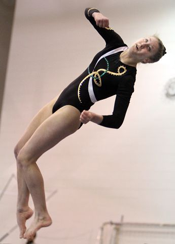 Stevenson's Caitlin Pagano competes on the beam at the North Suburban Conference girls gymnastics meet at Vernon Hills on Friday, January 28.