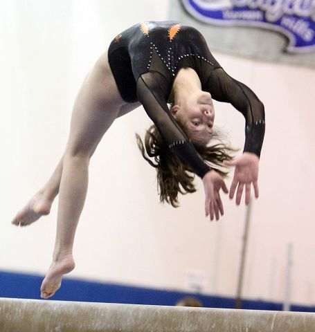 Libertyville's Lindsay Schweitzer competes on the beam at the North Suburban Conference girls gymnastics meet at Vernon Hills on Friday, January 28.