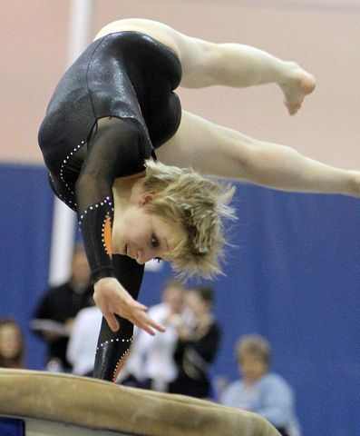 Libertyville's Tori Metcalf competes on the vault at the North Suburban Conference girls gymnastics meet at Vernon Hills on Friday, January 28.