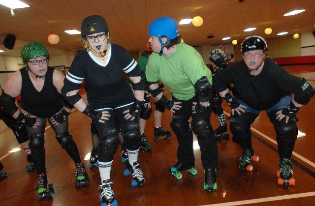The DuPage Derby Dames, shown practicing in Aurora, are bringing roller derby to the suburbs.