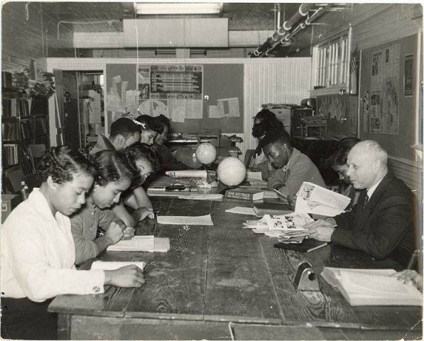 Professor Ernst Borinski, a Jewish refugee in Nazi Germany, teaches black students in the social science lab at Tougaloo College in Jackson, Miss., about 1960.