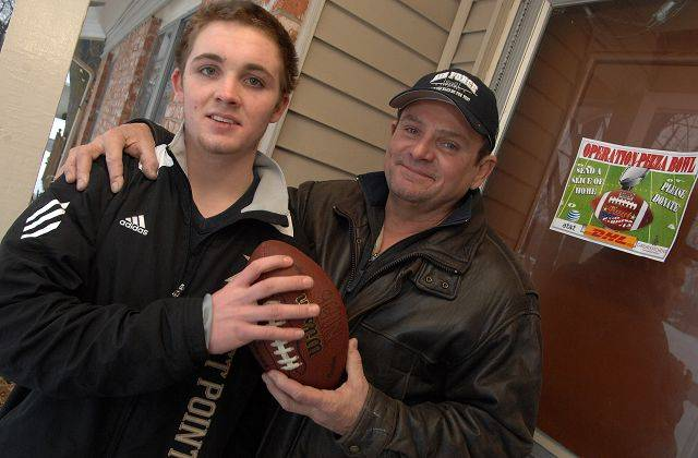 Mark Evans and his son Kent, 18, standing Friday in front of their Elk Grove Village home, plan on once again supplying the troops in Afghanistan with pizzas on Super Bowl Sunday.