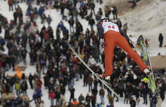 Robert Dzivrniewicz, of Poland, is airborne over the crowd during his jump on the K70 hill at the Norge Ski Club international tournament in Fox River Grove Sunday. This year's competition drew more jumpers than ever before.