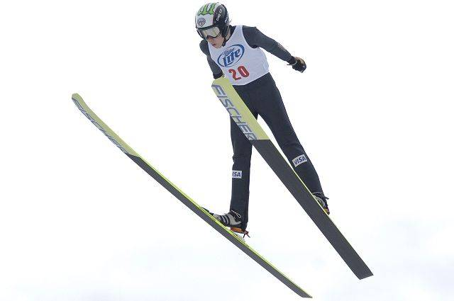 Ryan Johnson of St. Paul, Minn. flies off the jump of the K70 hill at the Norge Ski Club international tournament in Fox River Grove Sunday.